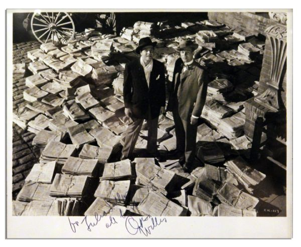 Orson Welles Signed 10'' x 8'' ''Citizen Kane'' Photo -- Welles as Kane Stands With Actor Joseph Cotton Among Stacks of ''The New York Daily Inquirer''