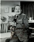 Walt Disney 7.25 x 9 Signed Photo Where He Holds a Baby Lynx