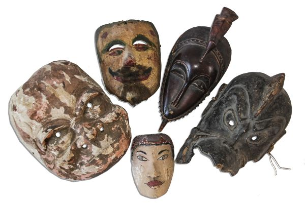 Ray Bradbury Owned Lot of 5 Masks -- Painted Mask With Goatee, Large Carved Wood Mask, Miniature Painted Mask, Porous Mask With Crested Head & African Guro Mask -- With COA From Estate