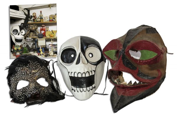 Ray Bradbury Personally Owned Trio of Masks -- One Signed by Artist Robert Beech -- Black & White Skull Mask, Feather Mask & Painted Fabric Mask -- 9'' x 10'' x 13'' -- With COA From Estate