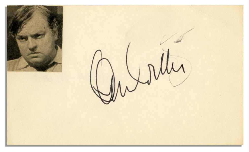 Orson Welles' Signature on a 5'' x 3'' Card With Welles' Photo Affixed -- Pencil Scratch, Else Near Fine