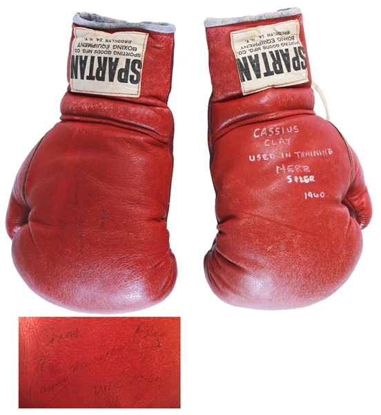 Muhammad Ali Fight Worn Boxing Gloves Cassius Clay, aka Muhammad Ali, Signed Boxing Gloves Used for His 2nd Professional Fight in 1960 -- Large Signature Measures Nearly 5'' Long, ''Cassius Marcellus Clay''
