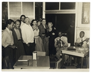 Photograph of Ernest and Mary Hemingway Enjoying a Private Concert Among Friends in Cuban Bar