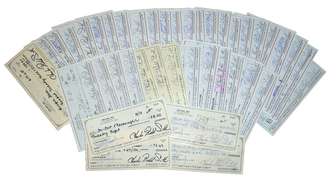 Lot of 50 Checks Signed ''Charles Bubba Smith'' by the Football Star -- Very Good Condition With Standard Bank Cancellation Marks