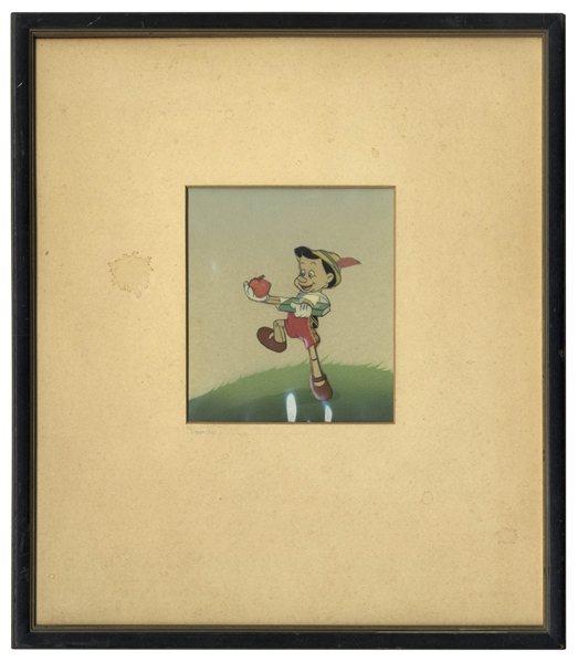 ''Pinocchio'' Animation Cel From the 1940 Disney Classic Film, Showing Pinocchio Holding the Apple for His Teacher -- With Hand Painted Set-up by Courvoisier