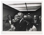 Cecil W. Stoughtons Personal, Unpublished Photo of LBJs Inauguration Aboard Air Force One -- LBJ Takes the Oath of Office as Jackie Stands Witness