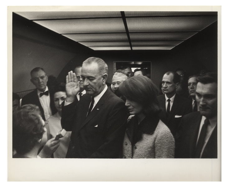 Cecil W. Stoughton's Personal, Unpublished Photo of LBJ's Inauguration Aboard Air Force One -- LBJ Takes the Oath of Office as Jackie Stands Witness