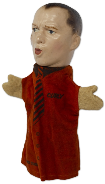 Curly Howard Hand Puppet, Circa 1937 -- With Painted Composite Head & Felt Hands & Shirt, Measuring 11'' Tall x 8'' Across -- Crack to Paint at Top of Head, Otherwise Near Fine -- Very Rare