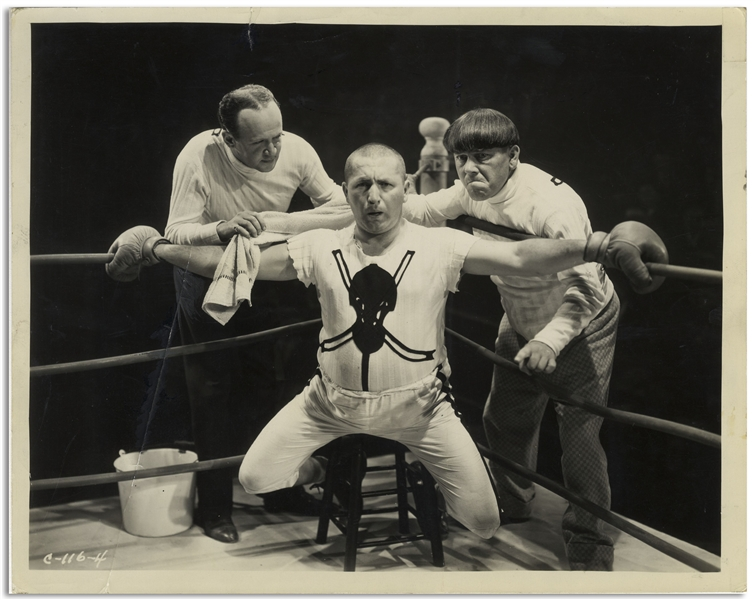 10 x 8 Glossy Photo From the 1934 Three Stooges Film Punch Drunks -- Diagonal Crease at Left, Else Very Good Condition