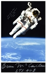 Bruce McCandless Signed 14 x 19.25 Photo of Him Performing the First Non-Tethered Spacewalk -- Reach for the Stars!