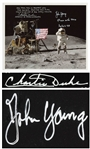 John Young and Charlie Duke Signed 10 x 8 Lunar Photo of Young Saluting the U.S. Flag During the Apollo 16 Mission -- Duke Additionally Writes, Hey John...Come give me a big Navy salute