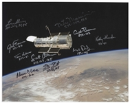 Photo of the Hubble Telescope, Signed by 10 of the Astronauts Who Have Viewed Hubble in Space -- Measures Over 14 x 11